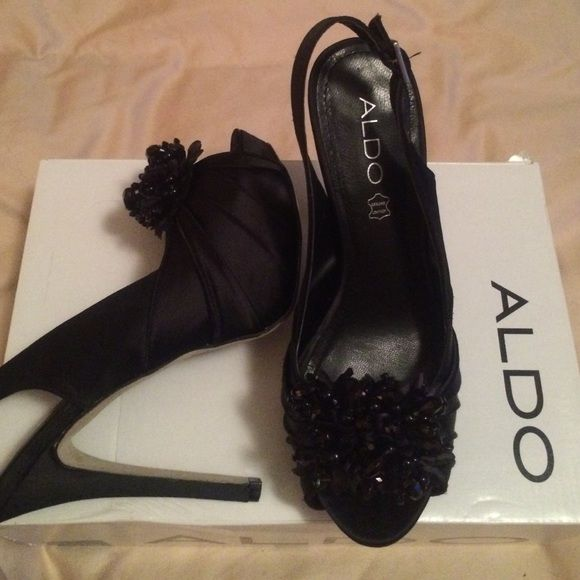 Beautiful black pumps! Just gorgeous Aldo heels, perfect for holiday parties, New Years or a stunning night out. Sling back with black satin peep toe, and beautiful black beaded bundle in toe. Sultis style size 7. Comes in original box. Worn for just a couple of hours one night. ALDO Shoes Heels