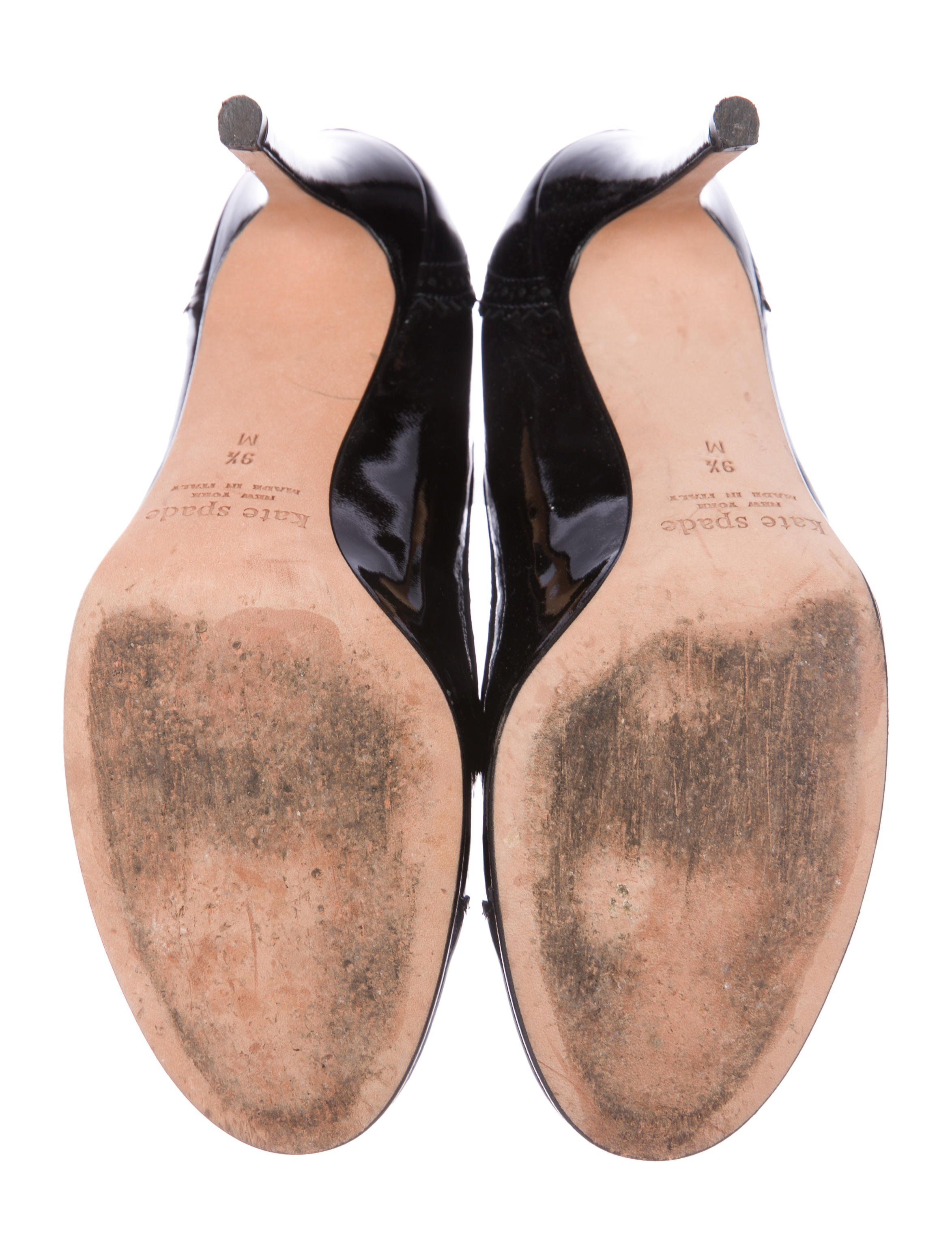 e3a7f754fc29 Black patent leather Kate Spade New York round-toe pumps with brogue trim  throughout leather