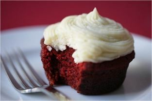 NYC's famous *Magnolia Bakery* red velvet cupcakes with creamy vanilla frosting.