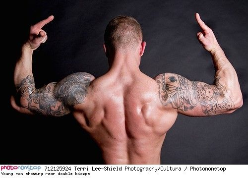 young man showing rear double biceps -- anatomie attitude biceps