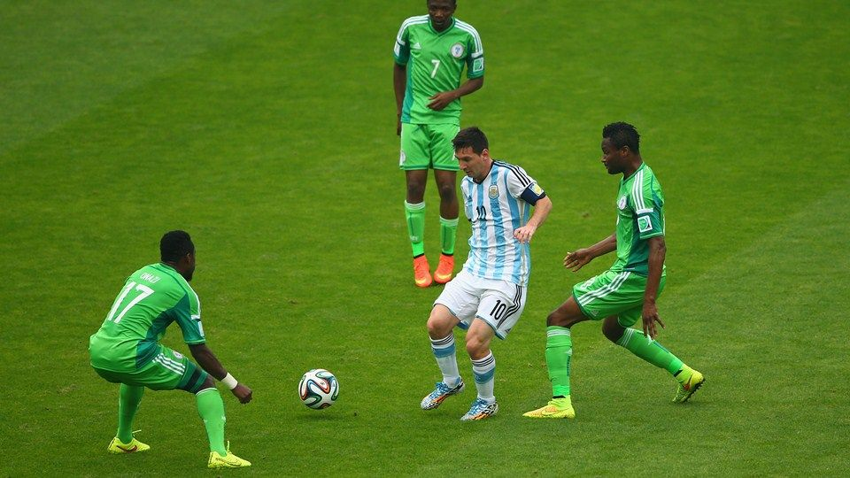 Messi Controls The Ball Against Ogenyi Onazi L Ahmed Musa C And John Obi Mikel Of Nigeria Fifa World Cup Fifa World Cup