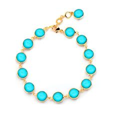 Syna 18 karat yellow gold 8 inch Chakra bracelet with 7mm turquoise discs.  Available for purchase online at www.leonardojewelers.com and  in our Red Bank, NJ and Elizabeth, NJ stores.
