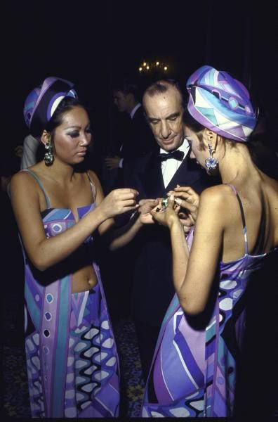1968, fashion designer Emilio Pucci with two young women wearing his iconic print designs, Bahamas