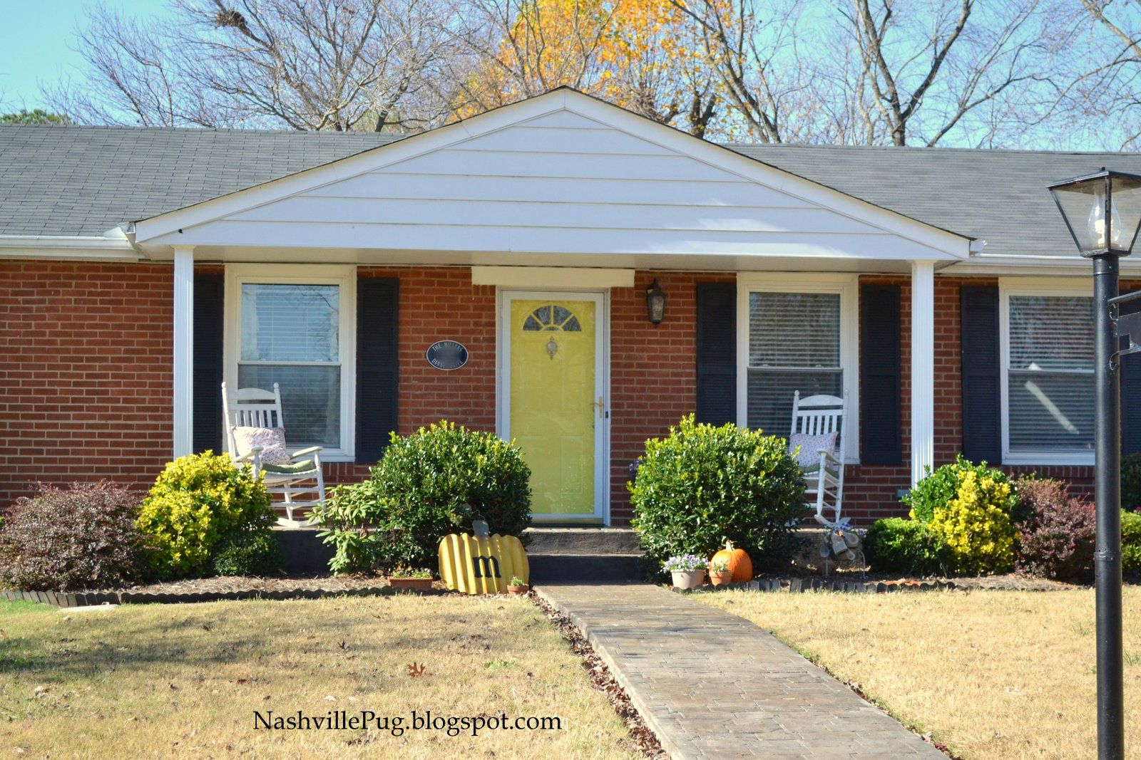 Yellow Door On A Brick Ranch Paint Color Is Goldenrod By Glidden Brick Ranch Houses Ranch House Exterior Red Brick House