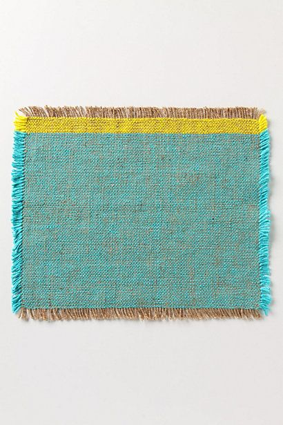 Rewoven placemats made of jute and recycled silk.