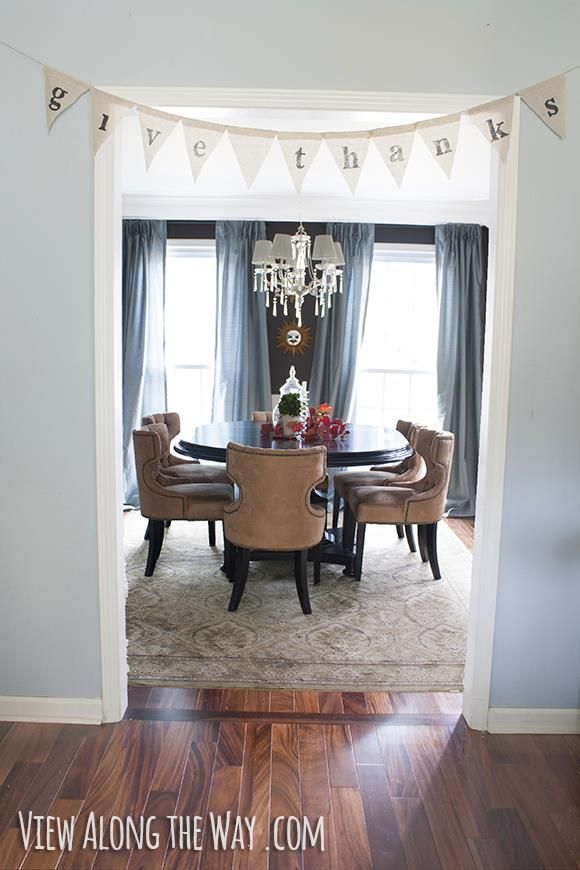 budget Dining Room with dark walls, upholstered chairs ...