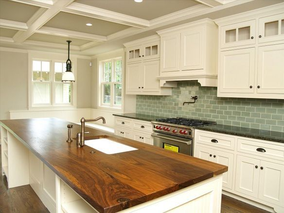 Dream kitchen! 1. Butcher block counters 2. White cupboards 3. substitute brick backsplash or something 4. stainless steel appliances. 5. Wood floors.  6. tray ceilings. All it's missing is butcher block on the back counter, An oversized sink would be great too. by Raelynn8