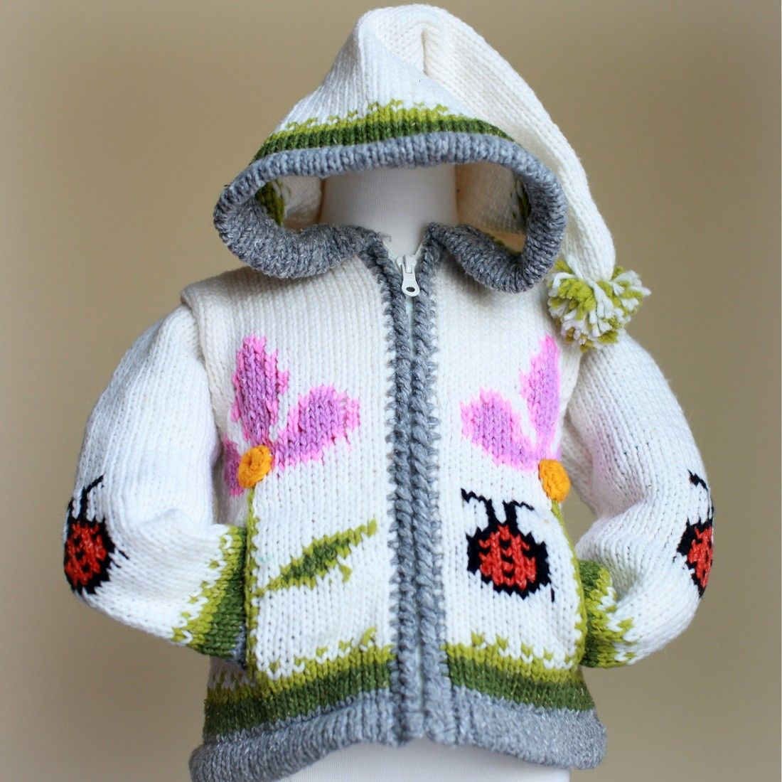 Floral Ladybug Sweater - With the two tone flowers and the grassy bottom, this sweet sweater will make your little one feel like she's in a sunny flower garden even on the gloomiest of days!
