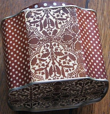 Side view of Altered tea tin with BoBunny papers . . .