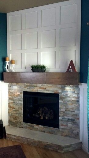 Our Fireplace remodel Desert quartz Ledgestone from Lowes, maple