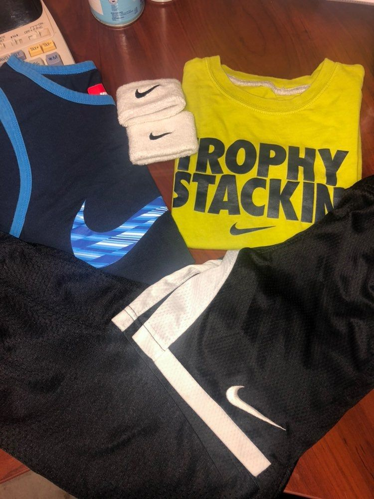 Kids athletic clothes 2 Nike shirts , 1 Nike short & 1