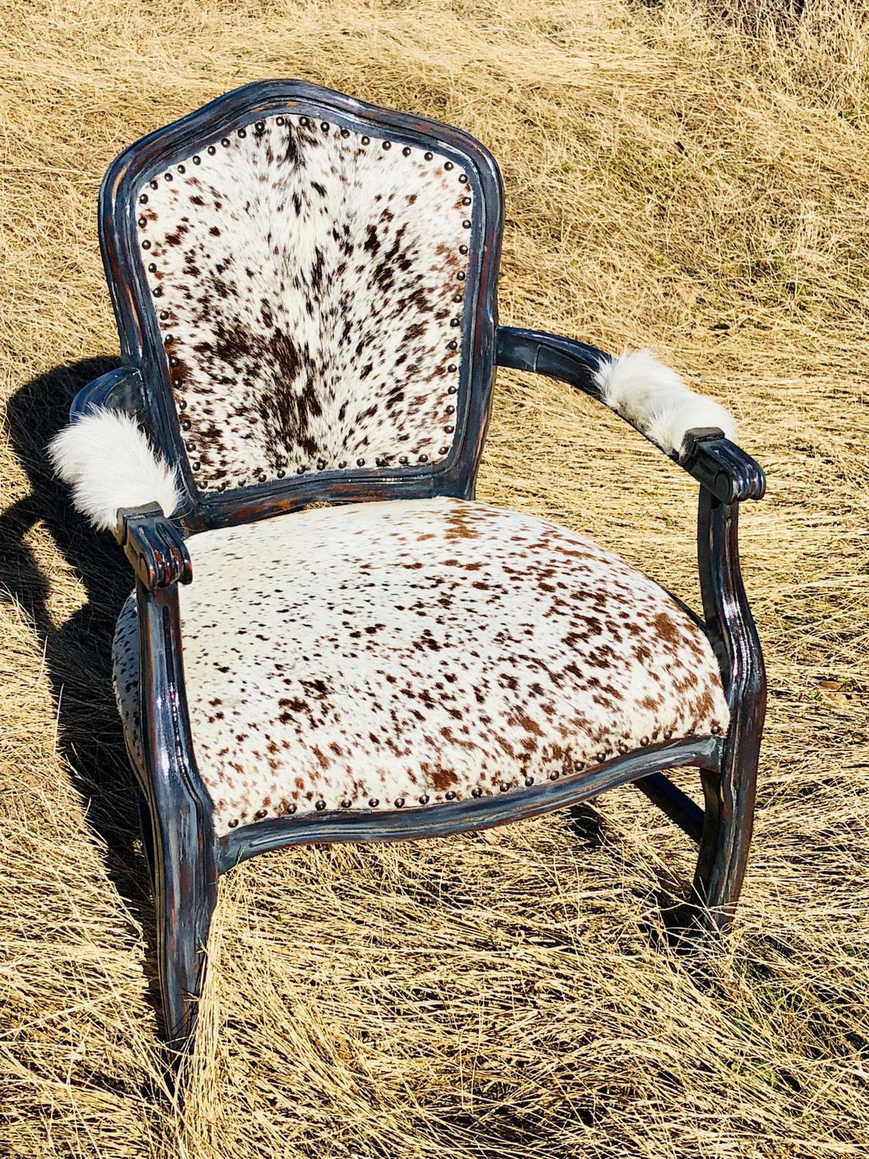 Cowhide armchair with a rustic farmhouse grey finish and