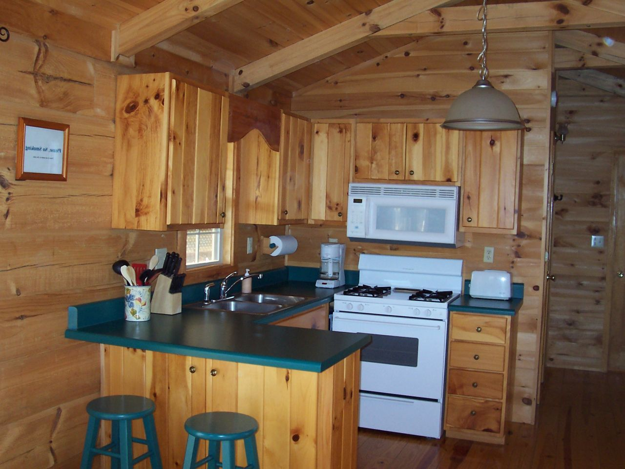 Small Log Cabin Kitchen Ideas - Blue to black white hob for black or ...