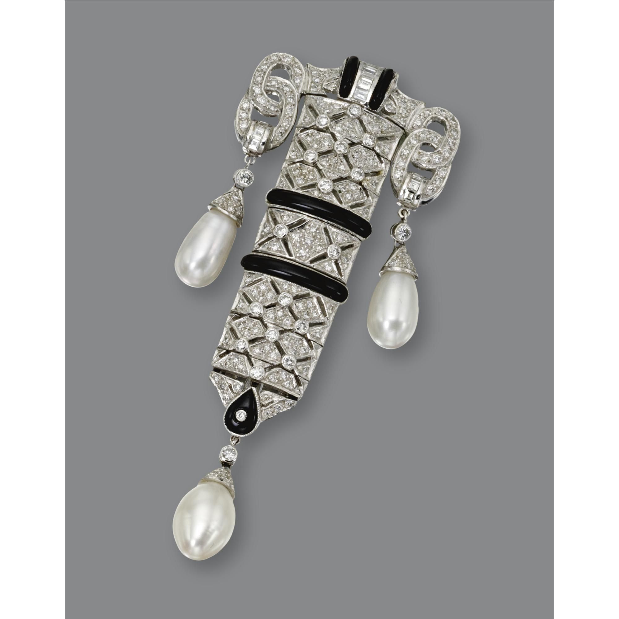 ART DECO DIAMOND, ONYX & CULTURED PEARL PENDANT-BROOCH The articulated pendant of geometric design set with 185 small round & baguette diamonds weighing approx 1.45 cts, accented further with bands of black onyx & 3 cultured pearl drops, in 18kt white gold, supported on an 18kt white gold chain.