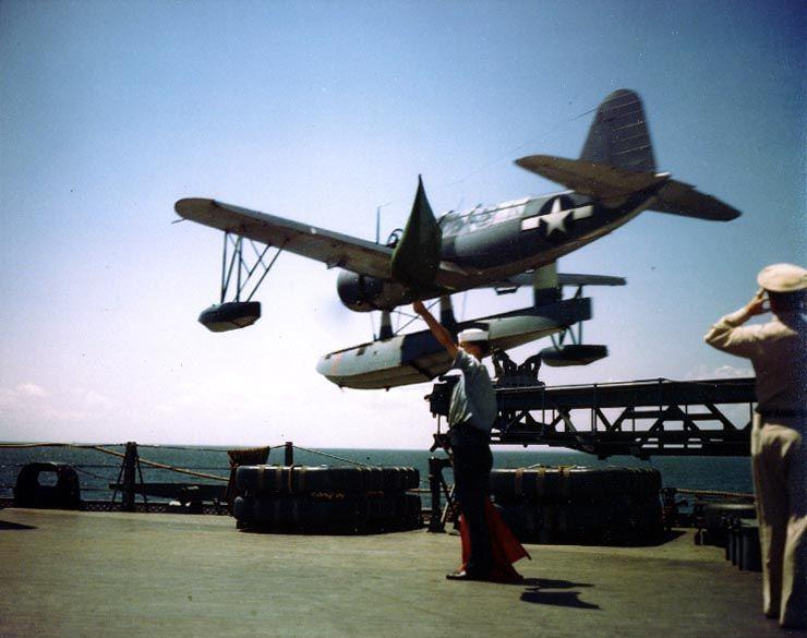 Catapult crew of battleship Missouri launching an OS2U Kingfisher aircraft, circa Aug 1944