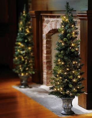 Prelit Christmas Tree Topiary for outside that won't blow over easily. | Christmas tree topiary ...