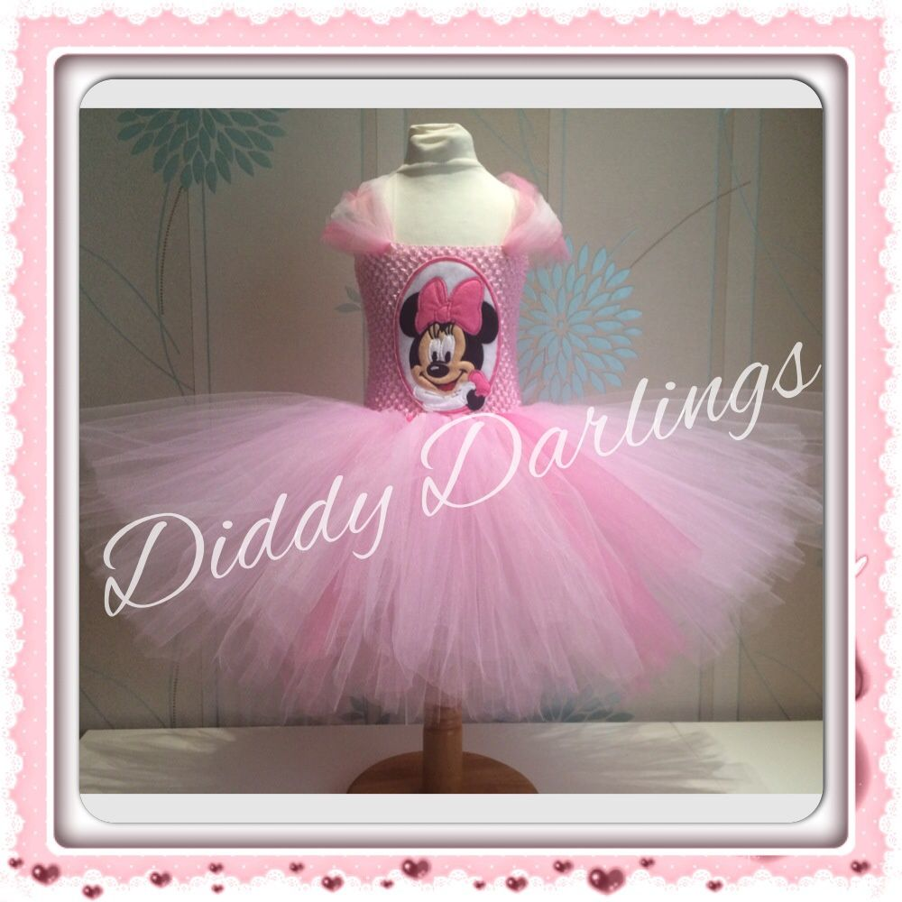 Minnie Mouse Tutu Dress.  Pink Minnie Mouse Tutu Dress.  Pink Minnie Mouse Dress.  Pink Tutu  Beautiful & lovingly handmade.   Price varies on size, starting from £25.  Please message us for more info.   Find us on Facebook www.facebook.com/DiddyDarlings1 or our website www.diddydarlings.co.uk