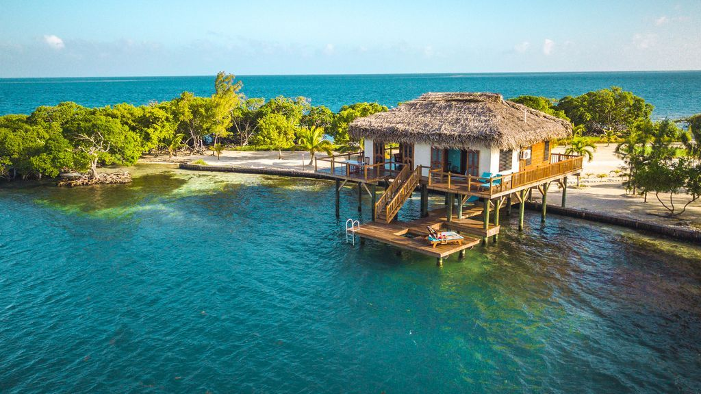 Belize private island rental with over water bungalow