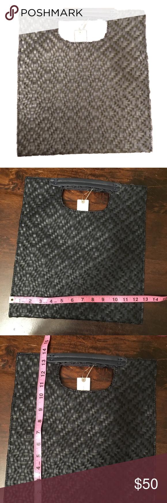 21dcb42ba7 Anthropologie Cara Woven Fold Over Clutch Noir and black basket weave  purse. Interior zipper pocket and two noir satin slip pockets.