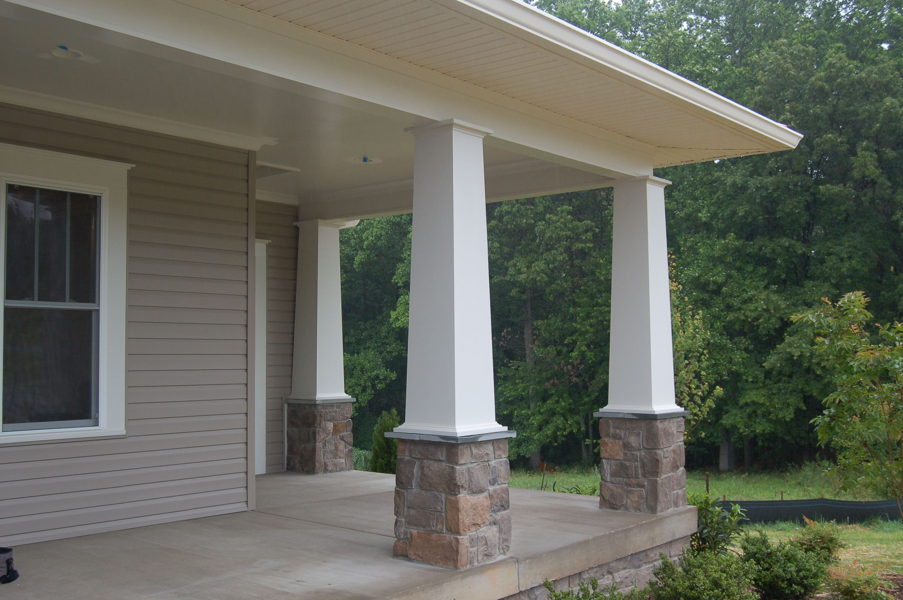 Quaker Kelsea Model With Stone Columns Front Porch