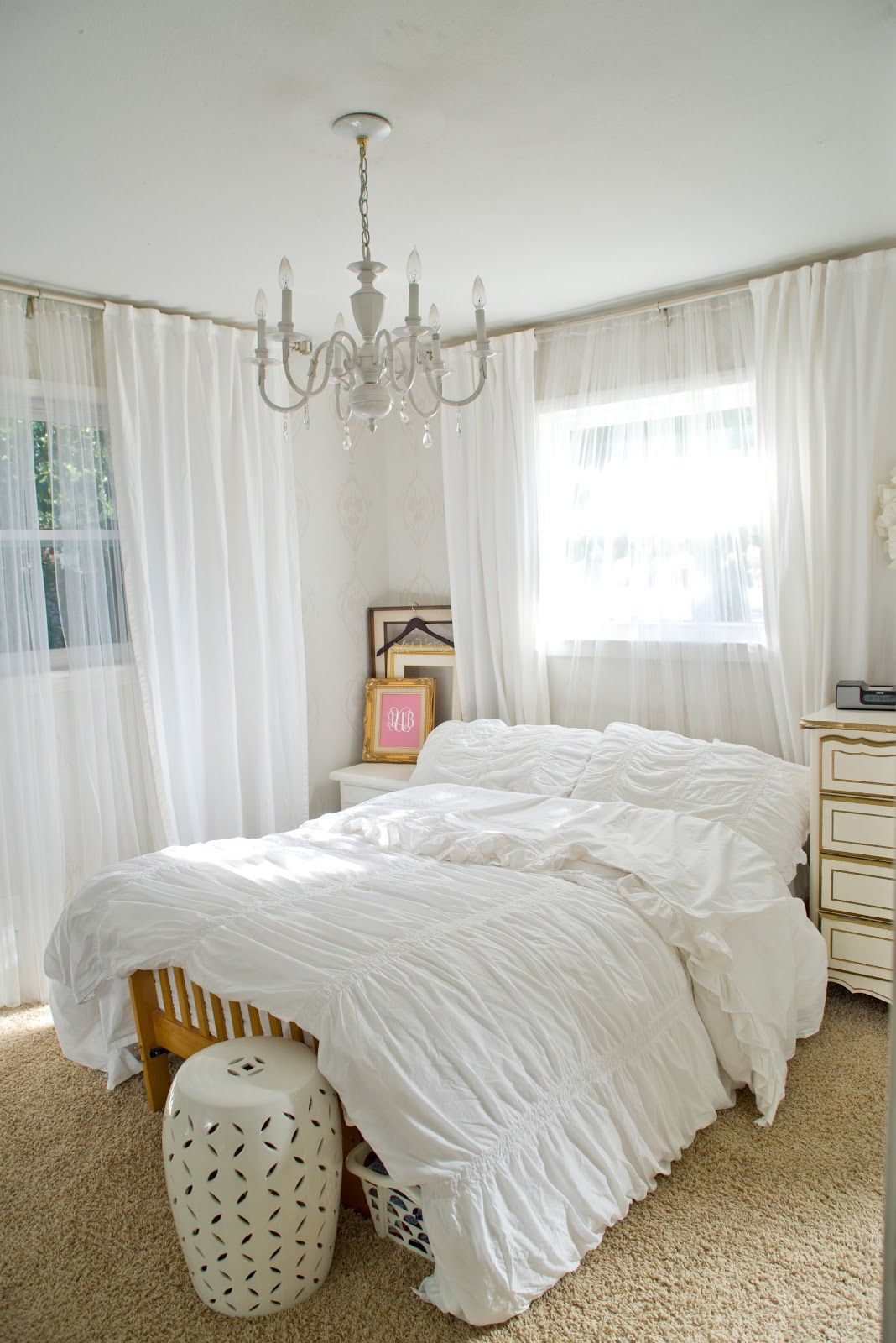 All White Bedroom With Chandelier And Curtains; Romantic; Faint  Stencil/pattern On Wall