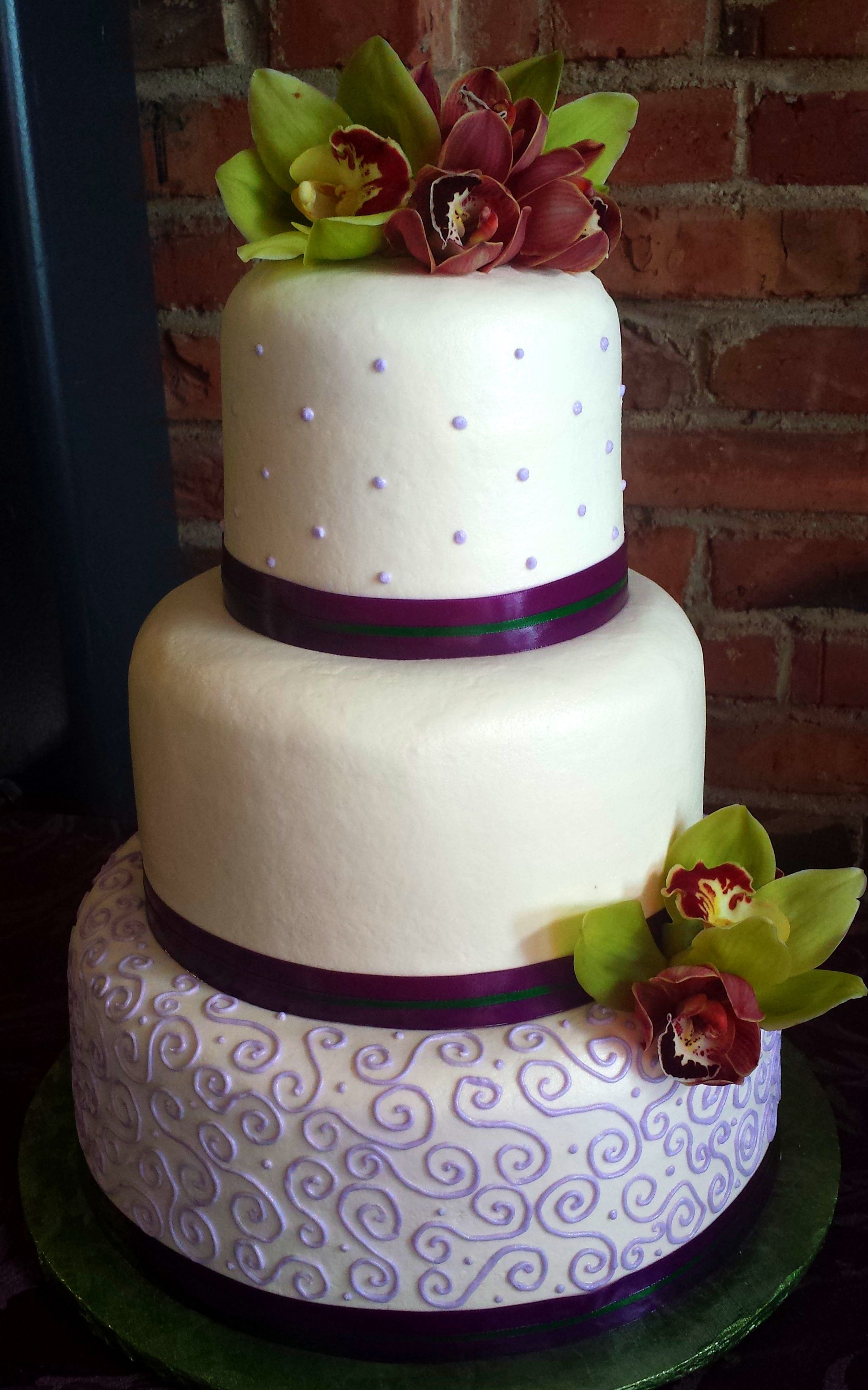 buttercream wedding cake made to look like fondant with purple