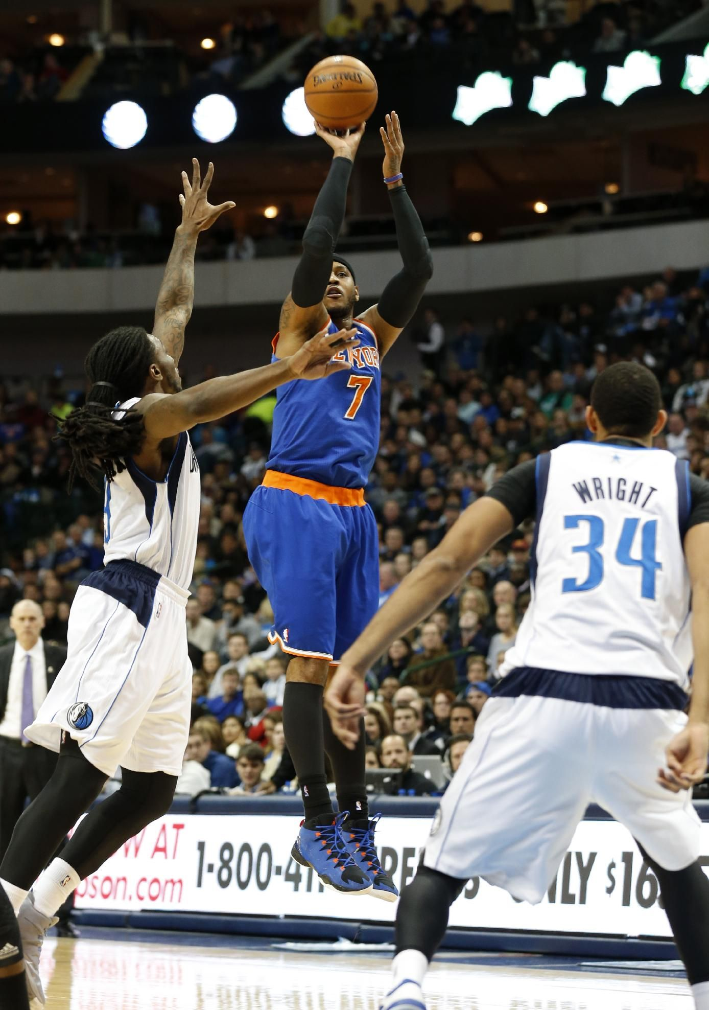12d96932f09 Dallas Mavericks forwards Jae Crowder (9) and Brandan Wright (34) defends  as New York Knicks forward Carmelo Anthony (7) takes a shot during the  first half ...