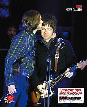 Tom kissing Noel Gallagher