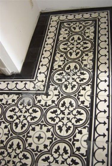 Pattern tile with solid tile around Powder room T i l e s