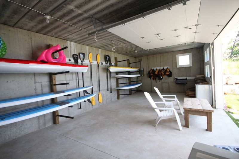 Beach style garage and shed by cottage home inc beach for Garage boat storage
