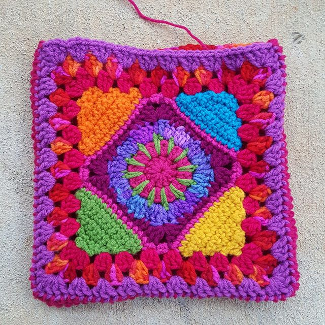 Two crochet granny squares joined, crochetbug, crochet squares, crochet triangles,c crochet purse