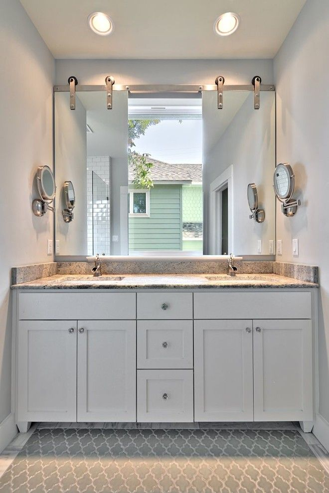 Barn Door Hardware Attached To Mirrors In Front Of A Window Over A Vanity Image By Avenue B Dev Bathroom Windows Bathroom Recessed Lighting Amazing Bathrooms