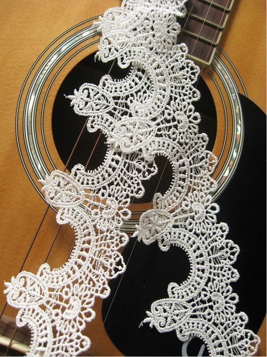 Antique lace trim in white gothic pattern