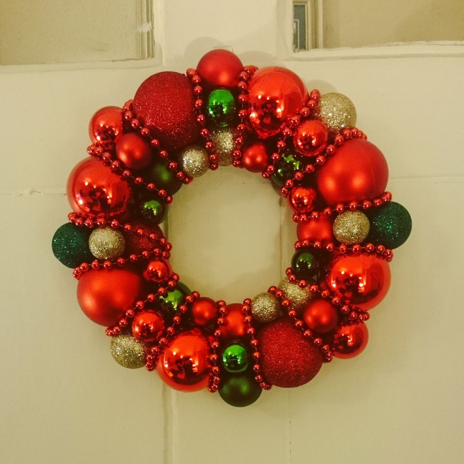 Items similar to Red, Gold and Green Christmas Bauble Wreath Decoration on Etsy
