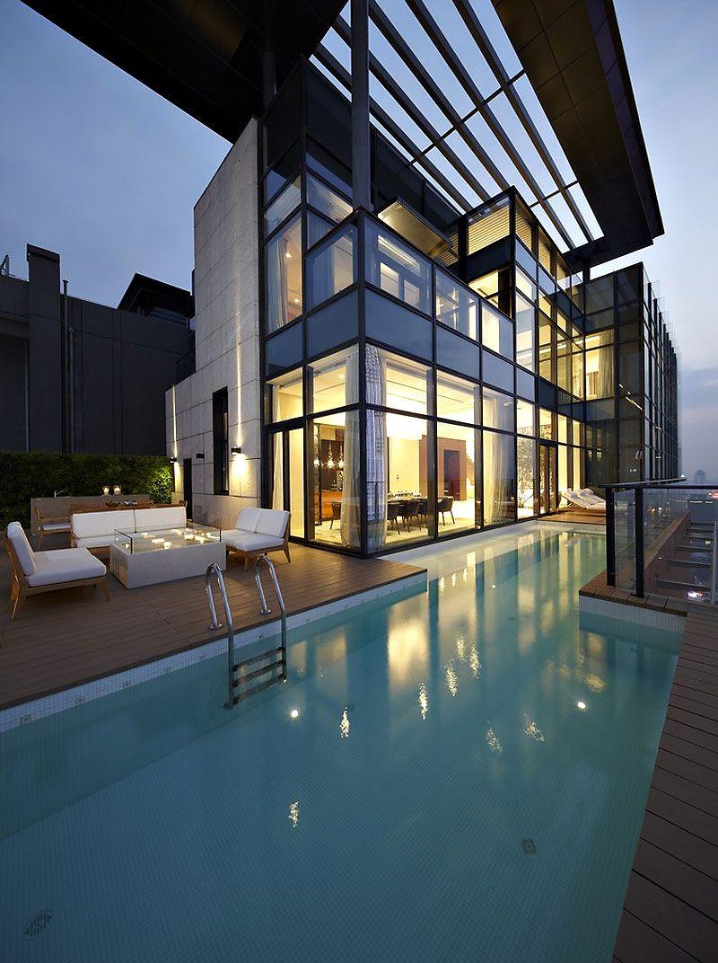 Amazing duplex penthouse in china by kokaistudios hogar for Casa moderna 7 mirote y blancana