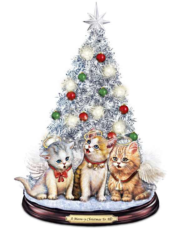 decorated tabletop christmas tree features the jingle cats meow ing their way through a medley of christmas songs
