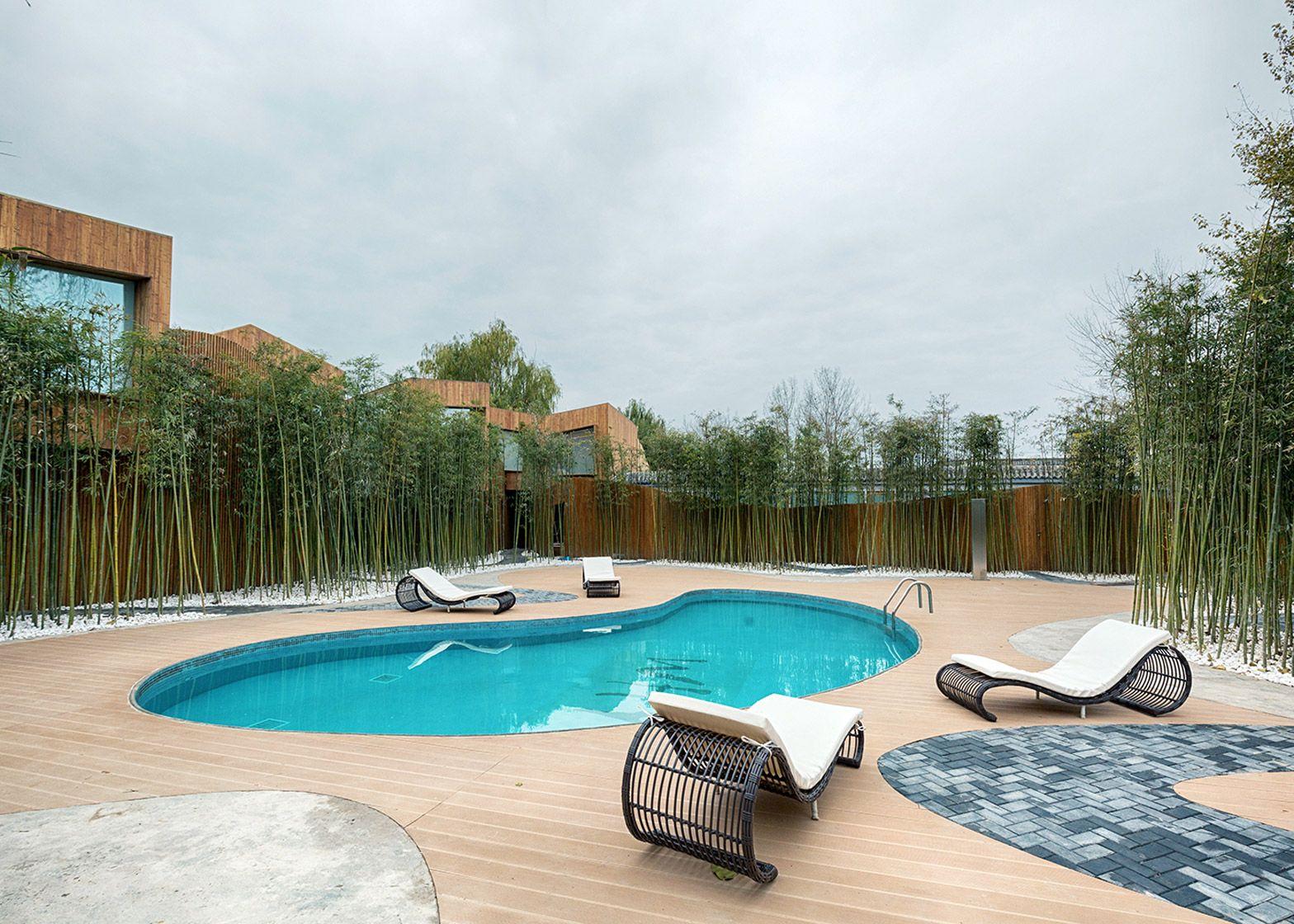 Elevation wooden cabins surround Beijing spring