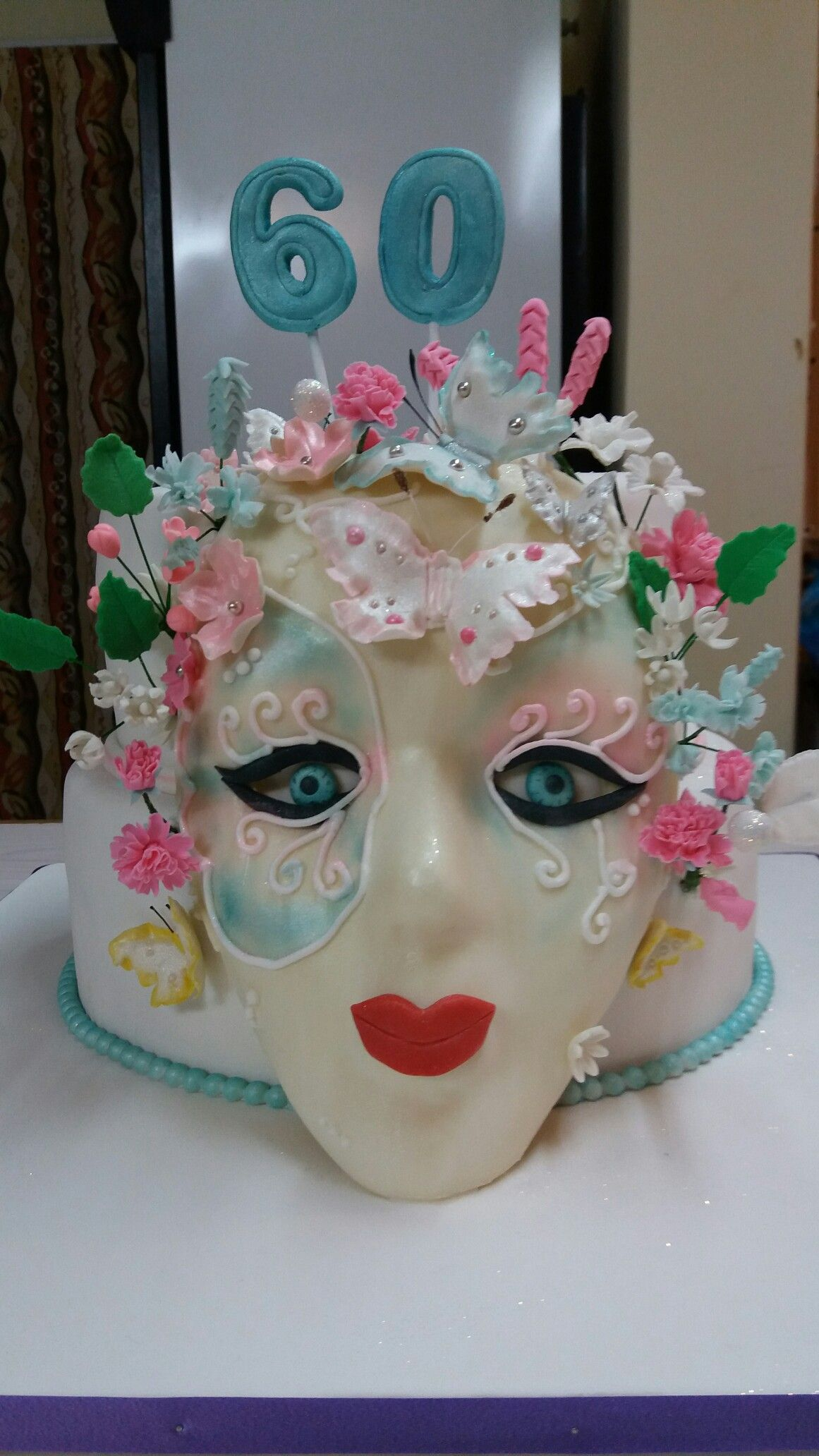 60th birthday butterflies and mask cake, made by Colleen de Wet.