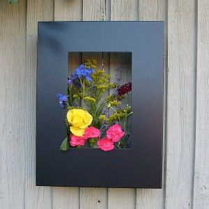 Contemporary garden Living art garden planter frame is part of Contemporary garden Planters - Looking for something a bit different to add a new perspective to your garden  Forget having all your planters positioned on ground level and get yourself some living art frames  These cleverly designed frames house small plant pots to create a framed art effect hanging to have on a wall or fence outside  Use them …