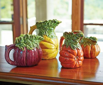 Pour on the fall color and flavor. Made of highly detailed, hand-painted ceramic, these festive pitchers celebrate pumpkins, eggplant and squash in vivid ripe color.