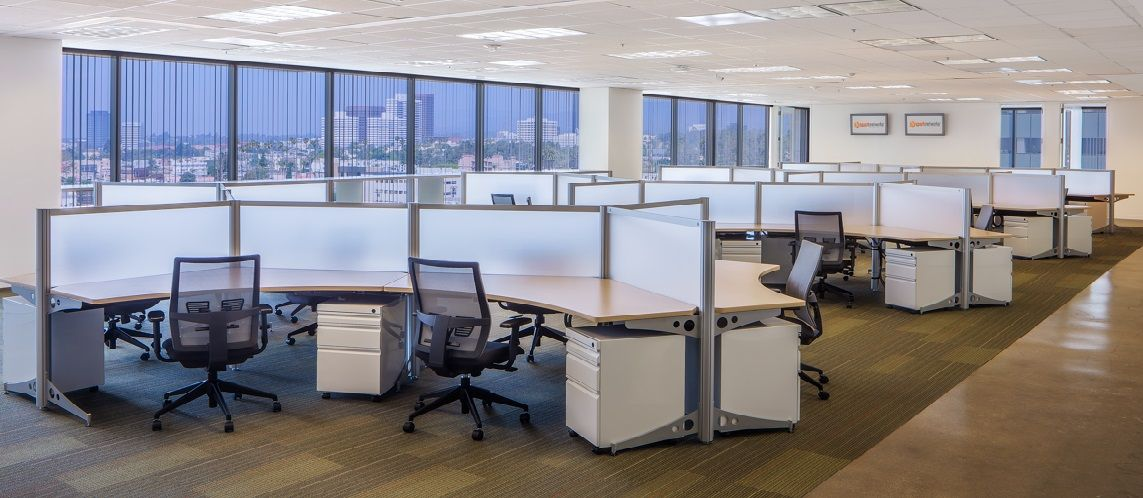 Office layout transitions going from traditional to for Open space office