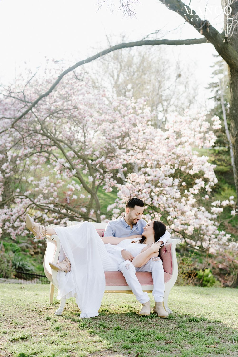 The Blossoms Really Make Romance Right The Elegance And The Way The Trees Frame Outdoor Engagement Photos Toronto Wedding Photographer Wedding Photography