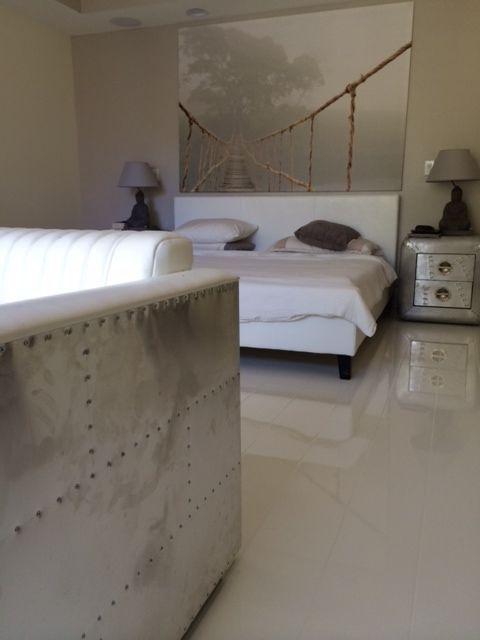 A Beautiful Modern Bedroom Using Elesgo Super Gloss White Laminate Modern Laminate Bedroom Zen Modernroom Luxury Vinyl Flooring Vinyl Flooring Flooring