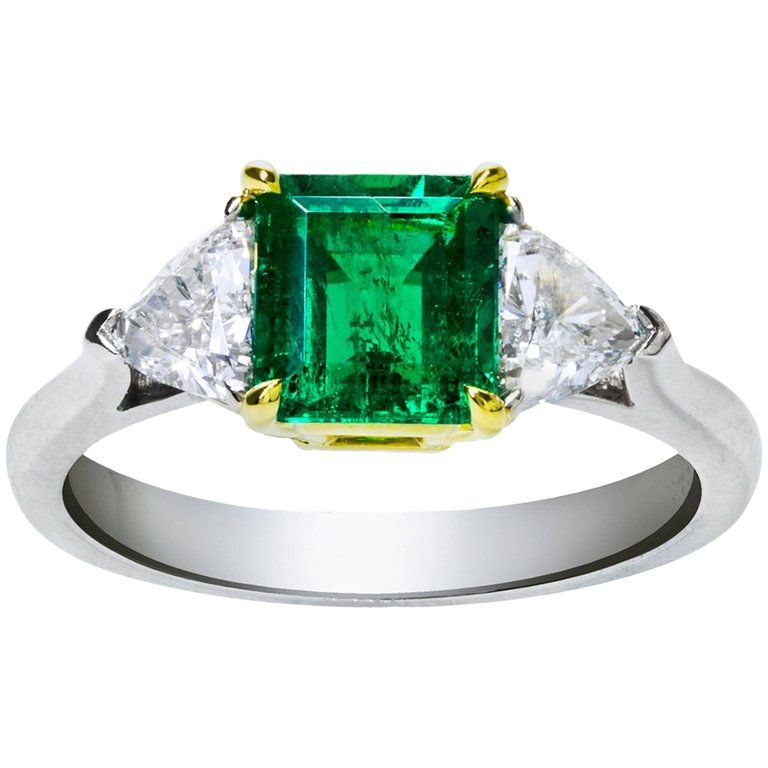 $17,500. Green Emerald &  Diamond Three-Stone 18k Gold and Platinum Ring | From a unique collection of vintage engagement rings at https://www.1stdibs.com/jewelry/rings/engagement-rings/