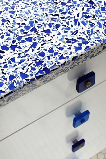 Recycled glass countertop: Blue glass with white cabinet