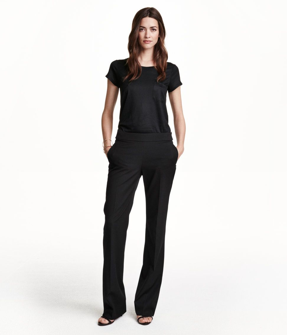 b9c2ccca Black flared pants with metal buttons & side pockets. | H&M Modern Classics