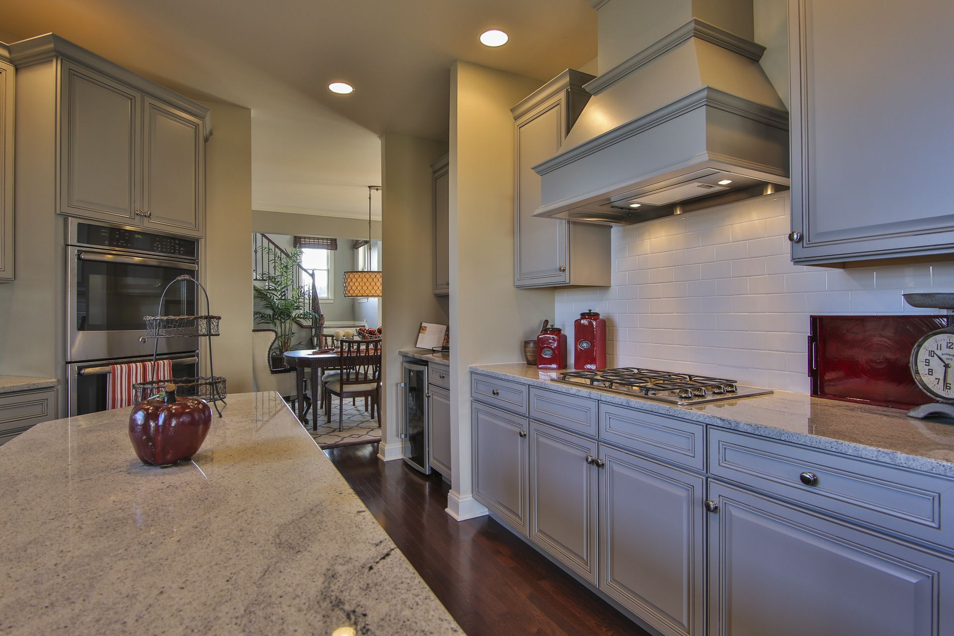 Super sleek and stylish grey cabinets round out this ...