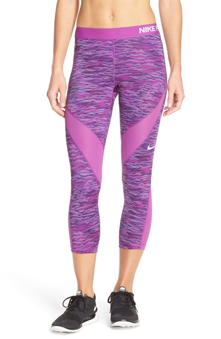 f633c9b2e4dd7 Adoring the cosmic purple color of these capri leggings from Nike. They're  topped by a snug elastic waist and insets with stretch mesh for optimum ...