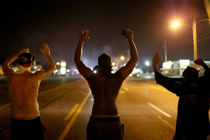 """Hands up, don't shoot"" has become a motto of the protests in Ferguson. (Photo by Joe Raedle, Getty Images)"