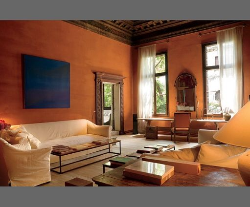 I like the terracotta walls and warm feeling addition for Orange walls living room designs